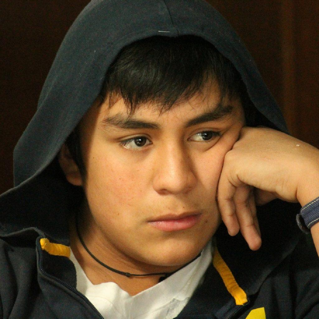 unhappy teenage boy